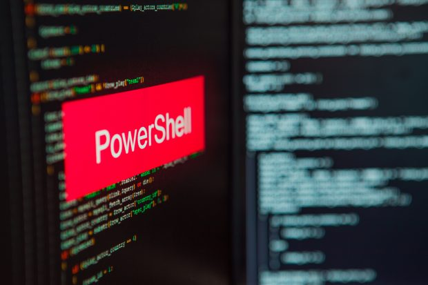 Programming language, PowerShell inscription on the background of computer code. Modern digital technologies and programming training